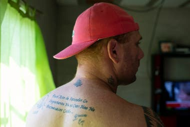 Matías has the motto of the Espartanos Foundation tattooed on his back: