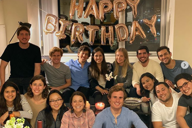 Ana and Nico along with colleagues and friends in their apartment in Boston on Ana's 26th birthday party