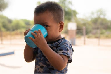 A child drinks water at School No. 1034, Lot 76, in Miraflores