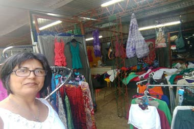 Andrea in her clothing stall:
