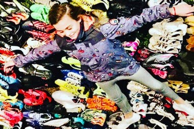 Zoe among the multitude of booties she managed to collect to donate.