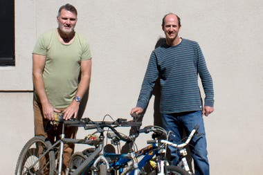 Coco, the president of Voy en bici (left), along with Federico, national coordinator (right) with bicycles donated to them this week in San Fernando