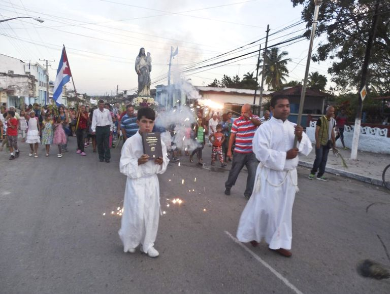A procession in Yaguajay, Cuba, where Father Peteira is